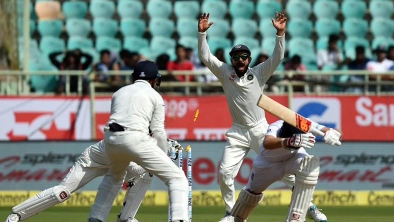 India's Virat Kohli (C) appeals unsuccessfully for a stumping against England's Joe Root (2R) during the last day of the second Test at the Dr. Y.S. Rajasekhara Reddy ACA-VDCA Cricket Stadium in Vishakhapatnam on November 21, 2016