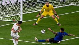 Swiss midfielder Steven Zuber (L) had a shot saved by Gianluigi Donnarumma (C) Creator: Riccardo Antimiani