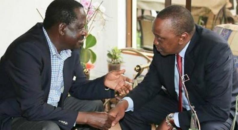 Nasa Raila Odinga with President Uhuru Kenyatta.