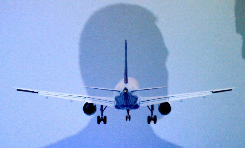 International Airlines Group CEO Walsh and Airlines for Europe A4E Managing Director Reynaert cast their shadows during a news conference in Brussels