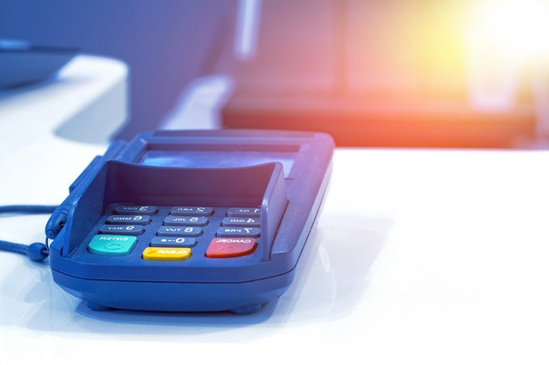 Payment terminal on table in restaurant.