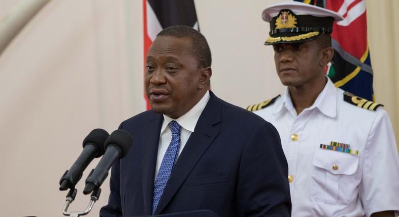 File image of President Uhuru Kenyatta and his  Aide-de-Camp Lieutenant Colonel Timothy Stelu Lekolool at State House Nairobi