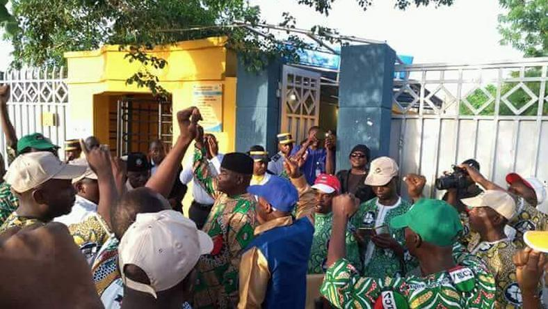NLC members protest in front of an MTN office