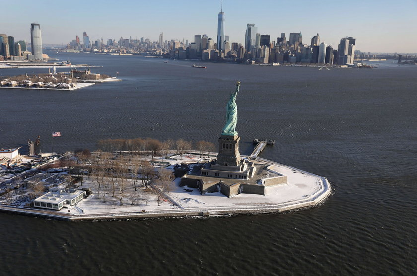 A sign announcing the closure of the Statue of Liberty, due to the U.S. government shutdown, sits ne