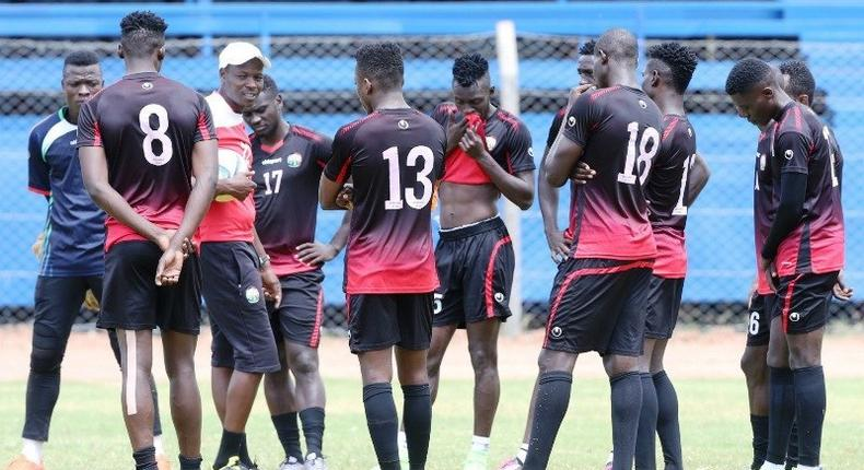 Harambee Stars Players with their coach Stanley Okumbi