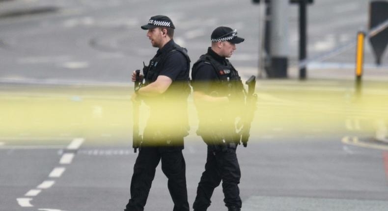 Armed police patrol near Manchester Arena on May 23, 2017 following a deadly terror attack in the city in northwest England