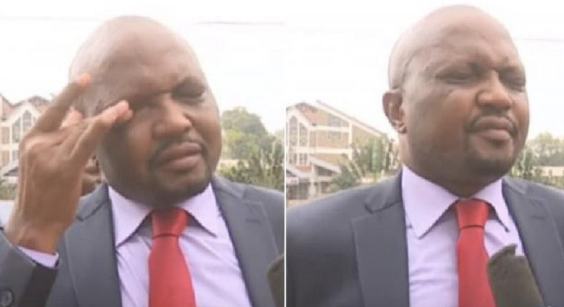 Gatundu South MP Moses Kuria wiping teargas from his face