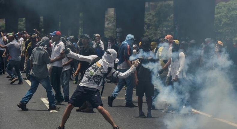 Marchers in Caracas were forced back by lines of soldiers and police deployed to contain what the opposition vowed would be the mother of all protests
