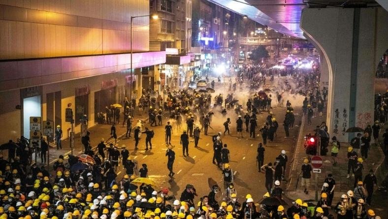 Tear gas filled Hong Kong's commercial district on Sunday