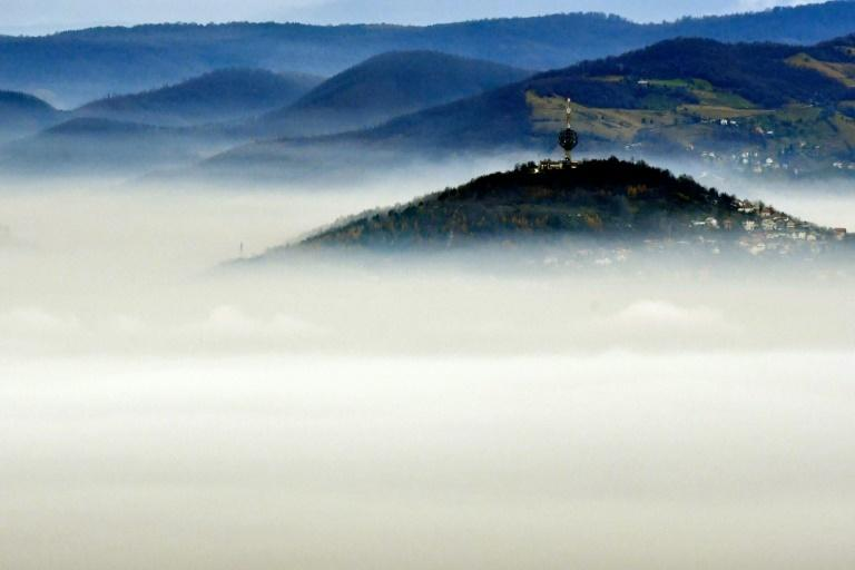 A ring of mountains helps trap the smog in valleys, shrouding Sarajevo residents in a grey fog