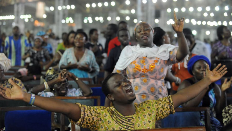 A service at a Pentecostal church on New Year's Day in Lagos, Nigeria, in 2014 [PIUS UTOMI EKPEI/AFP/Getty Images]