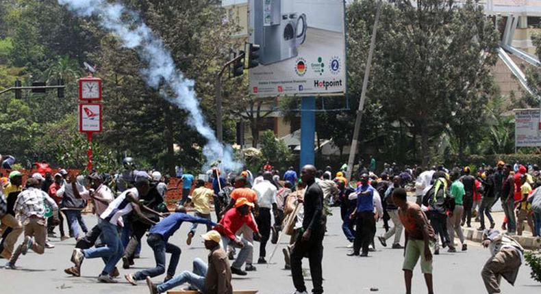 File image of police dispersing a crowd of demonstrators at a past political event