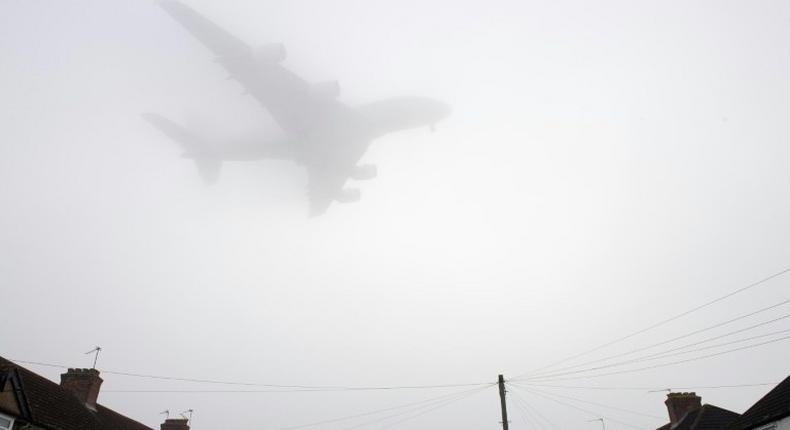 A Etihad Airways Airbus A380 comes in through the fog to land at Heathrow Airport in west London on December 30, 2016