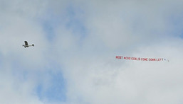 A light plane flies over England's training session on Saturday with a suggestion on Croatia tactics Creator: JUSTIN TALLIS