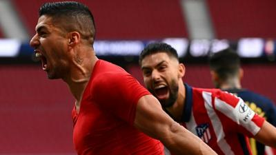 'Extraordinary' Suarez leaves Atletico on the brink of Liga title