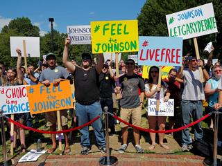 Supporters cheer at a campaign rally with Libertarian presidential candidate Johnson and vice presid