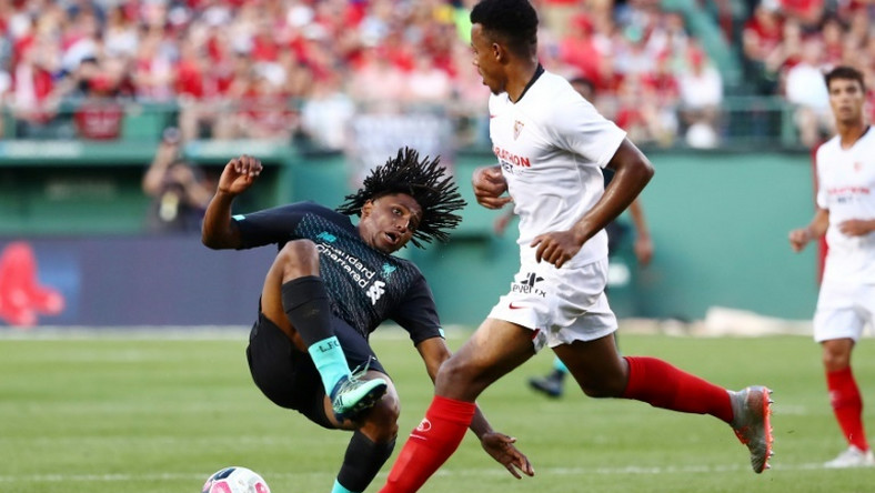 Yasser Larouci of Liverpool is fouled by Sevilla's Joris Gnagnon in Sevilla's 2-1 win in a pre-season friendly at Fenway Park