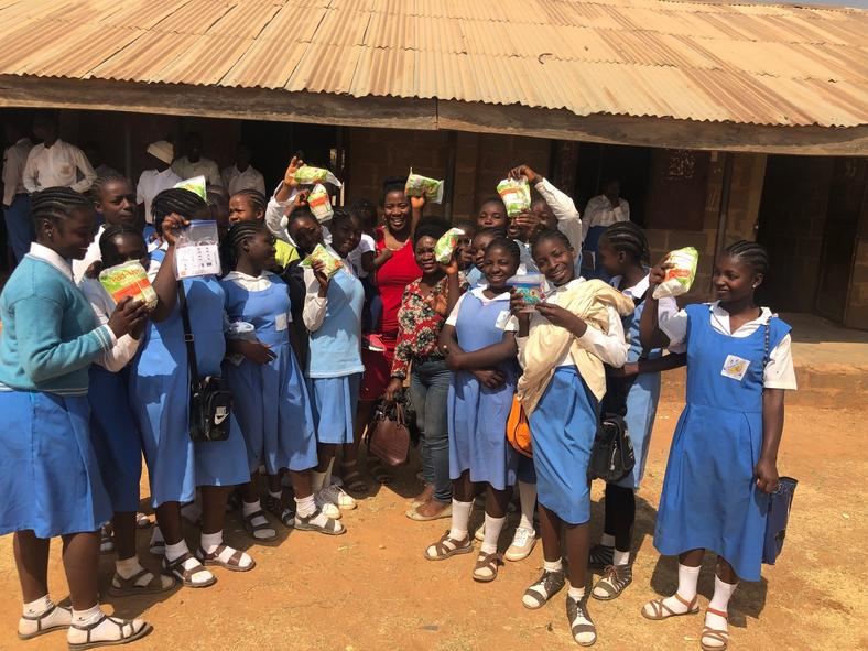 Omu and the students she distributed pads to in Jos, Plateau State. (Karo Omu/Pulse)