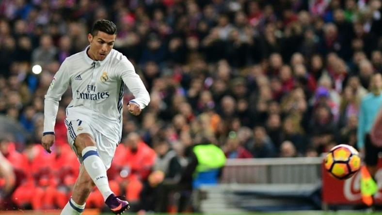 Cristiano Ronaldo scores for Real Madrid against Atletico de Madrid at the Vicente Calderon stadium on November 19, 2016