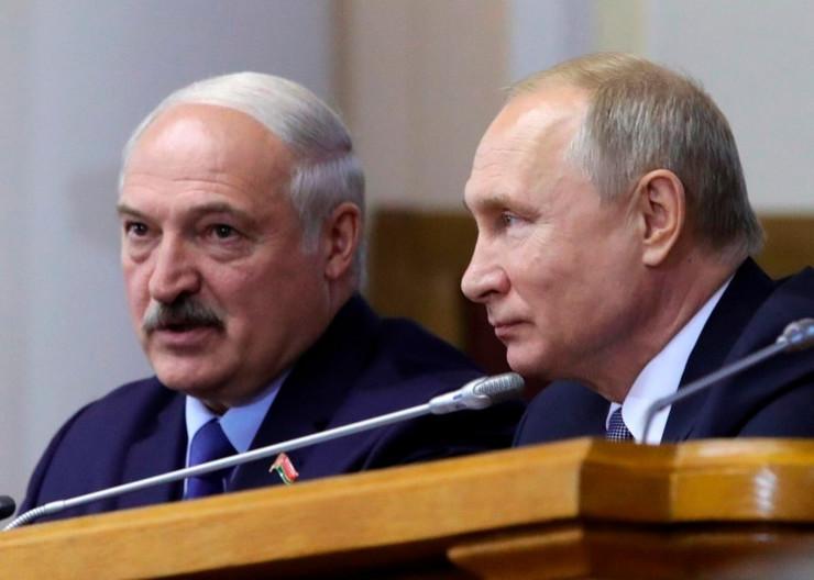 Aleksandar Lukašenko i Vladimir Putin AP