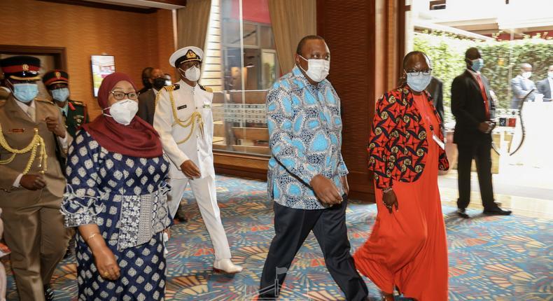 President Uhuru Kenyatta with Tanzanian President Samia Suluhu and Trade CS Betty Maina
