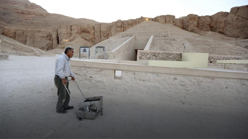File photo shows a Japanese radar specialist Hirokatsu Watanabe standing with his equipment outside King Tutankhamun's burial chamber in the Valley of Kings in Luxor, Egypt