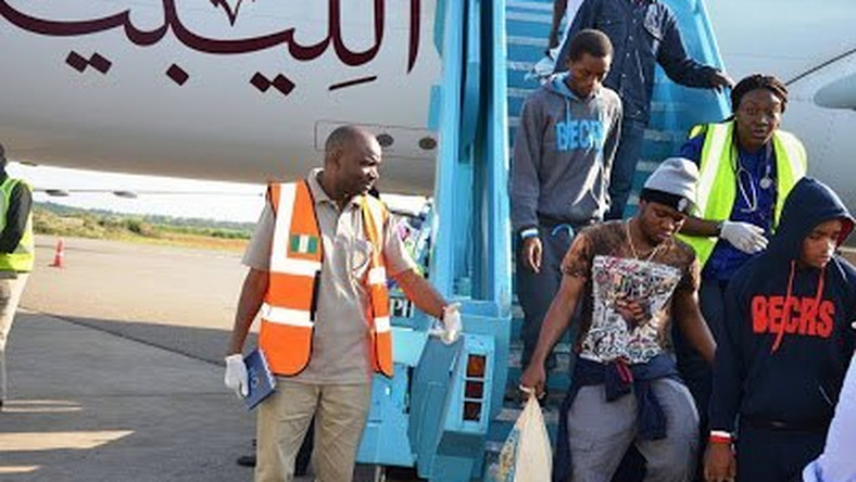 Nigerians alighting the plane from Libya
