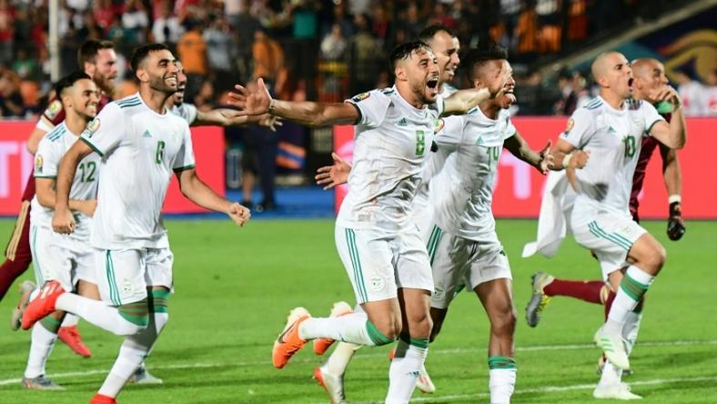 Algeria players celebrate their victory over Senegal in the Africa Cup of Nations final