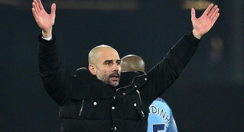 Manchester City's manager Pep Guardiola celebrates on the pitch after the English Premier League football match between Bournemouth and Manchester City at the Vitality Stadium in Bournemouth, southern England on February 13, 2017