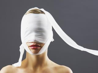 Bandage covering woman's face