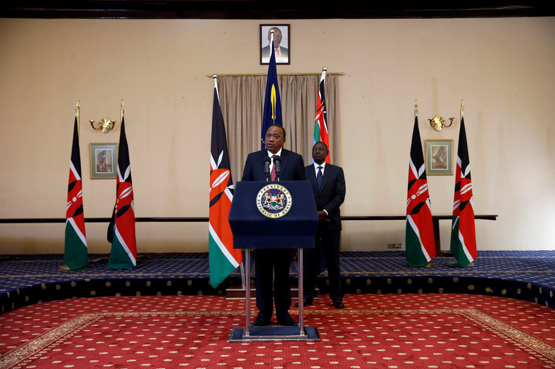 Kenya's President Uhuru Kenyatta and his Deputy William Ruto deliver a statement to members of the media at the State House in Nairobi.