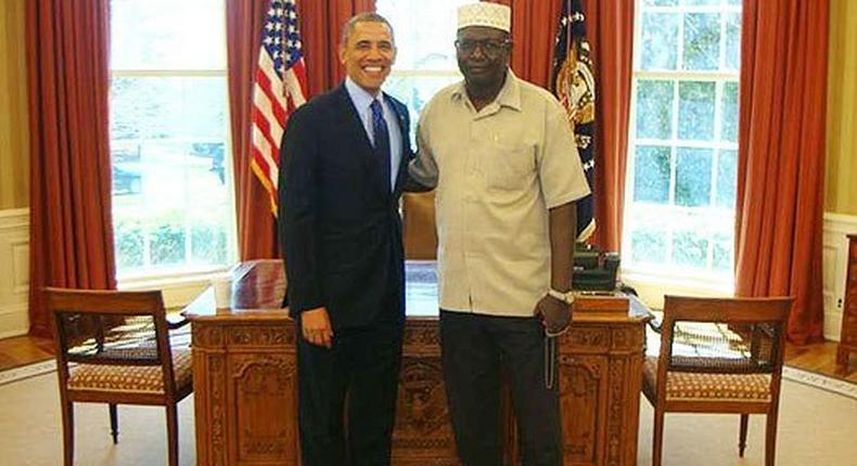 Former US President Barack Obama with his elder brother Malik Obama