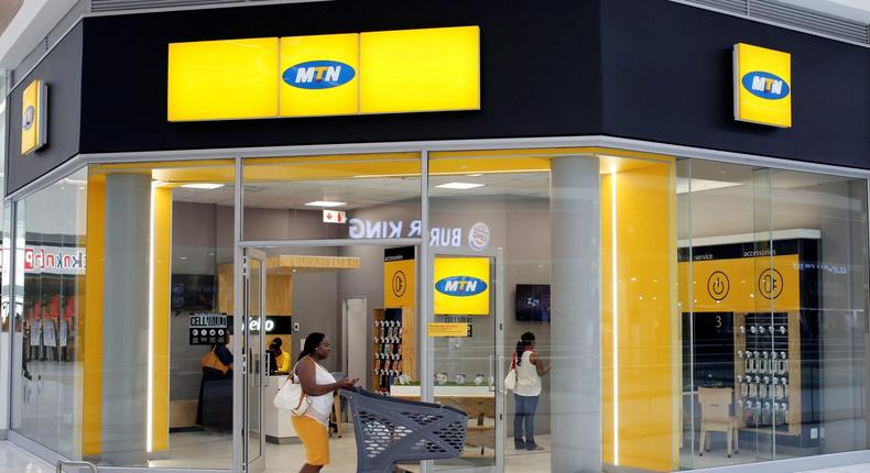 A shopper walks past an MTN shop at a mall in Johannesburg, South Africa, March 2, 2017 (REUTERS/Siphiwe Sibeko)