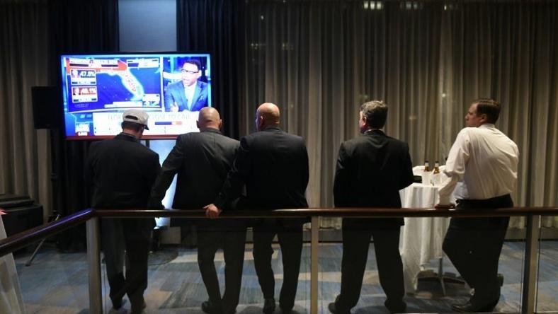 Supporters of Republican presidential nominee Donald Trump watch news reports as results come in during election night at the New York Hilton Midtown in New York