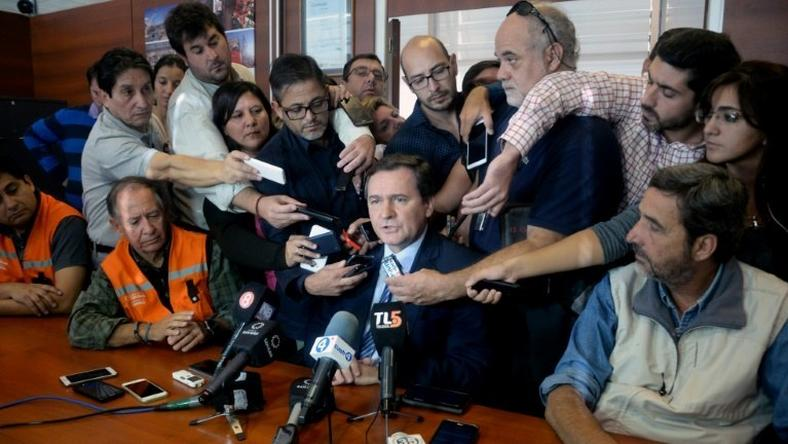 San Juan's province Mining Minister Alberto Hensel (C) speaking during a press conference in San Juan, west of Argentina on March 30, 2017