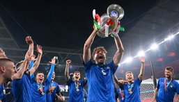 Italy midfielder Manuel Locatelli holding the Euro 2020 trophy. Creator: Laurence Griffiths
