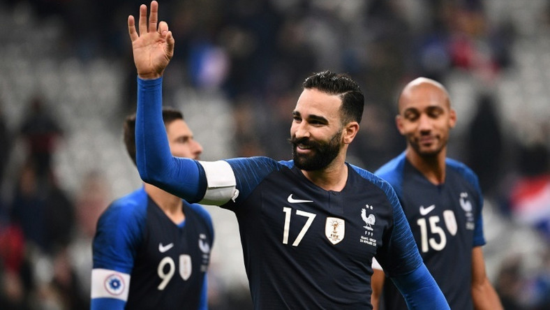 Marseille defender Adil Rami, shown playing for France, has been sacked by the club, reportedly for 'gross misconduct'