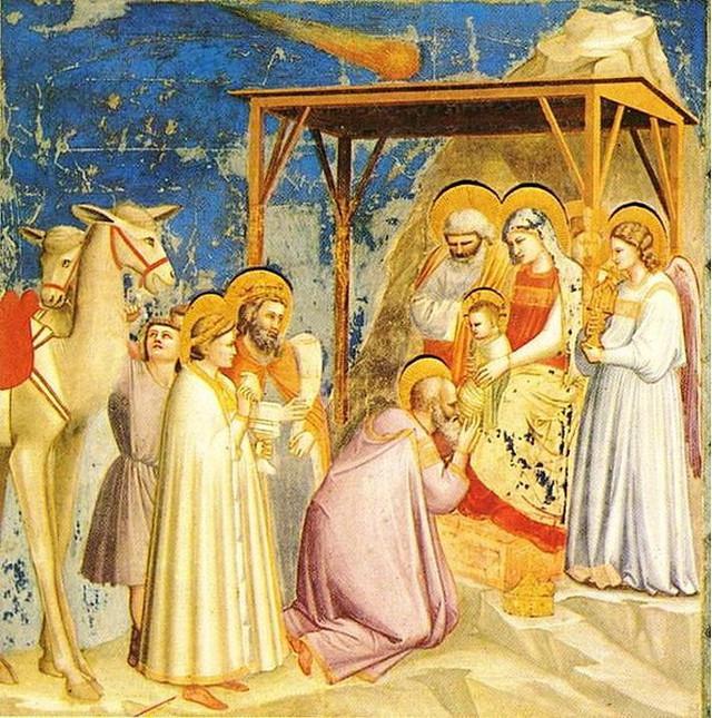 "Đotova slika ""Poklonjenje mudraca"" pokazuje tri mudraca kako se klanjaju pred bebom Isusom, a iznad njih sija Vitlejemska zvezda prikazana kao kometa"