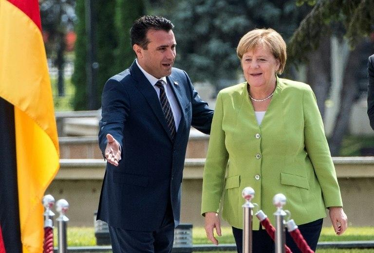 German Chancellor Angela Merkel (R) has tried to help Macedonia's Prime Minister Zoran Zaev (L) win a referendum on changing the country's name so it can pursue EU membership
