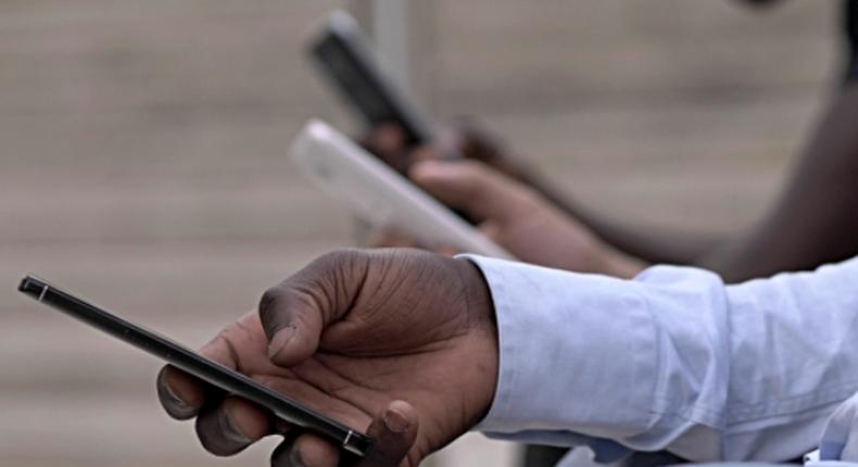 Kenyan on a mobile phone