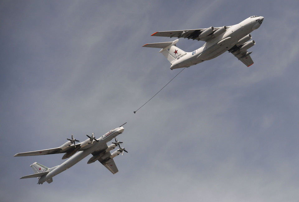 An Ilyushin Il-78 Midas air force tanker and a Tupolev Tu-95MS strategic bomber fly over the Red Square during the Victory Day parade in Moscow