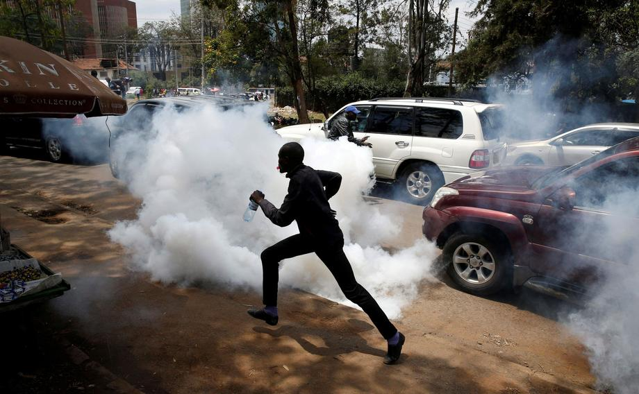 Supporters of Kenyan opposition National Super Alliance coalition run after policemen fired tear gas
