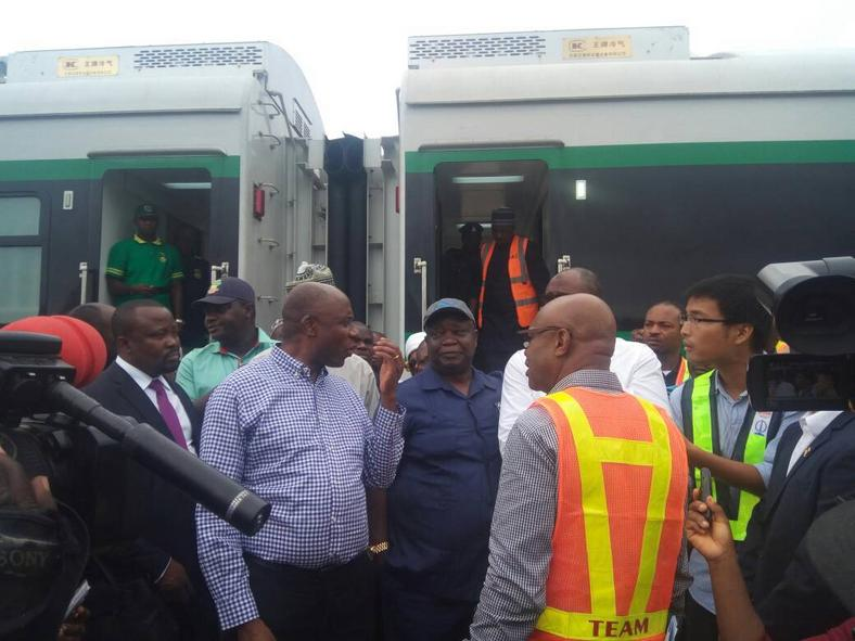 Transport Minister, Rotimi Amaechi, queries contractors on slow pace of the construction of Train Stations at the Itakpe-Ajaokuta-Warri rail line.