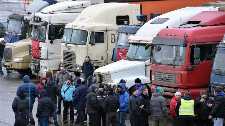 Russian long-distance truck drivers gather at a parking in Khimki, outside Moscow, on December 4, 2015, to protest against the Platon truck taxation system, a system against which truckers have launched a new protest