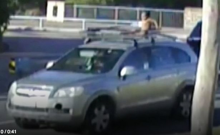 0_Baby-in-nappy-filmed-riding-on-ROOF-of-car-while-mum-drove-completely-unaware (1)