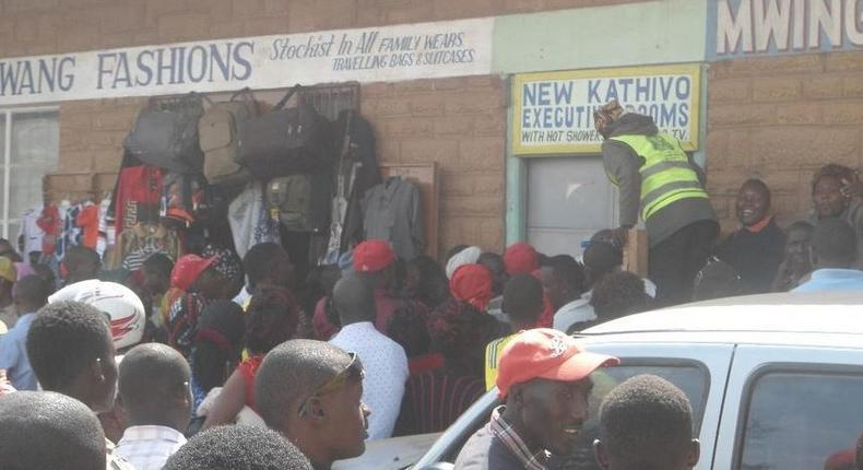 File image of a crowd outside a lodging where a man was caught engaging in sexual acts with a married woman