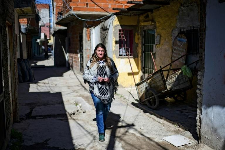 Dagna Avia walks through the poverty-hit Buenos Aires district of Villa 21-24 where her soup kitchen feeds 200 people a day