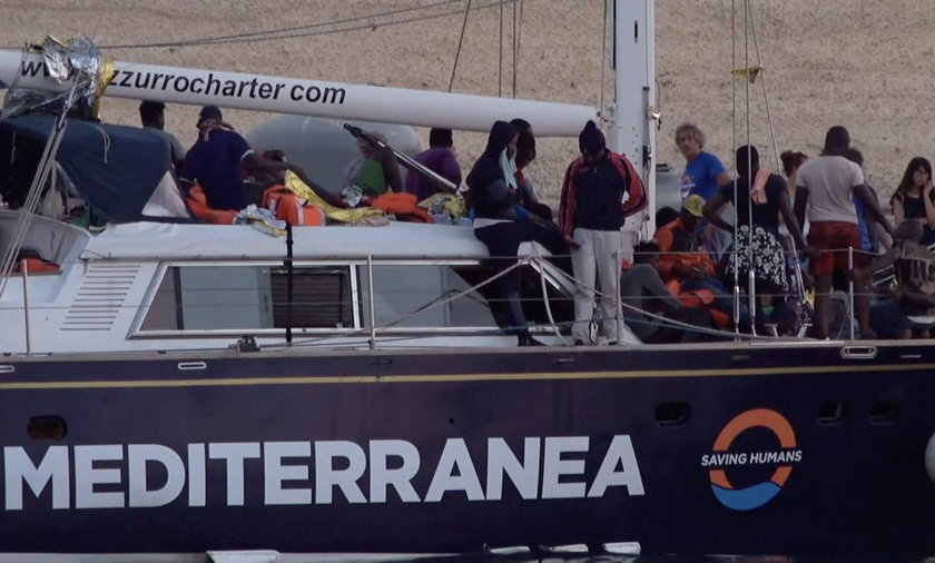 """A still image from a video footage shows migrants sitting on board of a migrant rescue boat """"Alex"""", after the vessel docked at the port of Lampedusa in defiance of a ban on entering Italian waters, in Lampedusa"""