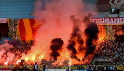 Esperance of Tunisia supporters light flares during the first leg of a CAF Champions League semi-final against Al Ahly of Egypt in Rades on Saturday. Creator: FETHI BELAID