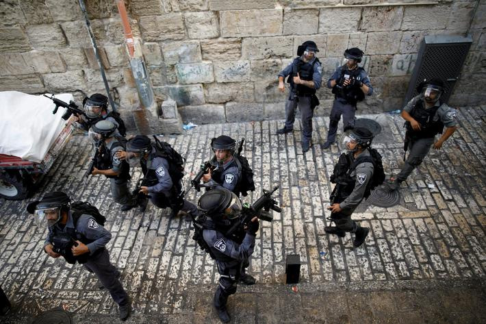 Israeli policemen guard a street at Jerusalems Old city outside the compound known to Muslims as No